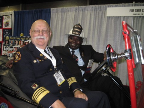 Nationals Fire Heritage Center booth at FRI in Atlanta, 2011.  Ronny Coleman with a friend from Ghana in Bill & Carole Killen's 1925 Model T Fire Chief's Buggy.